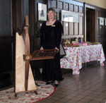 Alice Freeman and her harp at a Birthday Party in the Laramie Train Depot