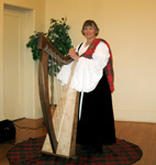 Alice Freeman in an authentic Celtic costume with her folk harp