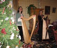 Alice Freeman and a friend with their harps in the Ivinson Mansion Parolor