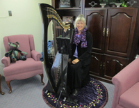 Alice Freeman and her Carbon Fiber Harp at a special celebration in the Regency Retirement Residence in Laramie