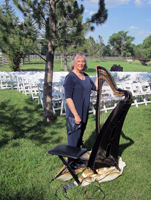 Alice Freeman and her Carbon Fiber Harp waiting for the start of a wedding at the Hereford Ranch east of Cheyenne, Wyoming