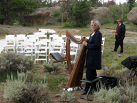 Alice with her harp at an outdoor wedding in Vedauwoo